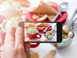 Photographing pistachios ice cream with cellphone camera,selective focus